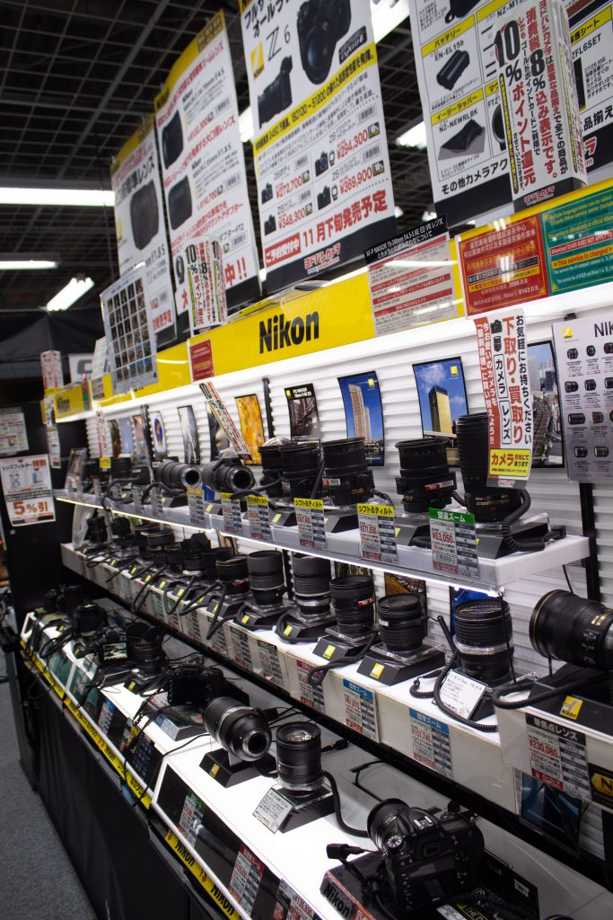 Camera lenses on display In Yodobashi Camera