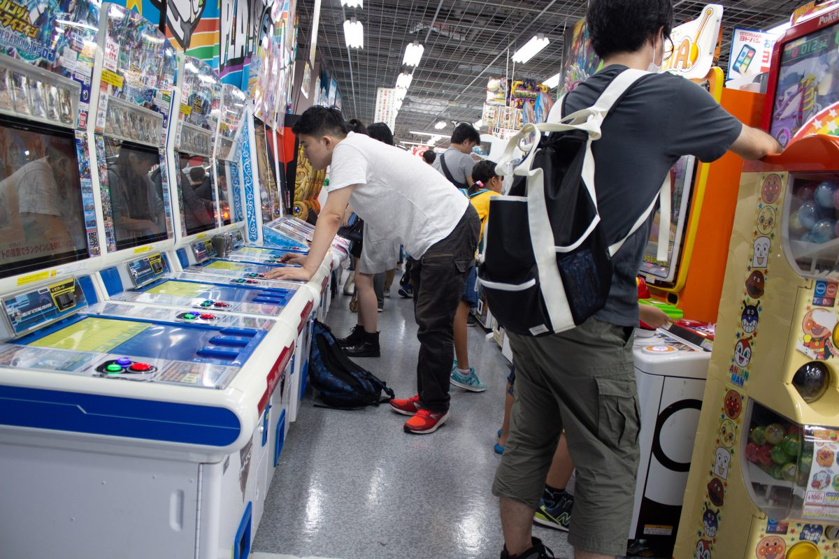 People playing arcade games In Yodobashi Camera