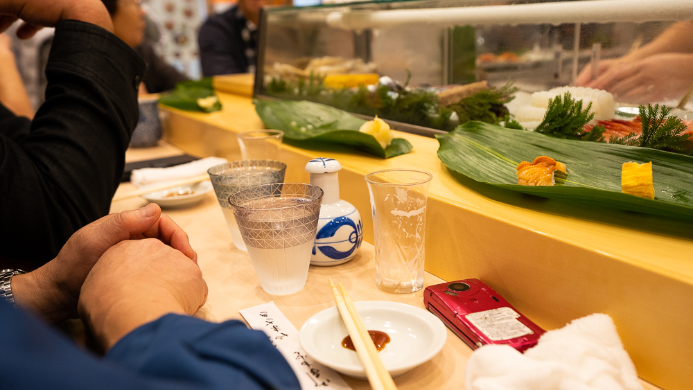 Eating best sushi with sake in Toyosu fish market