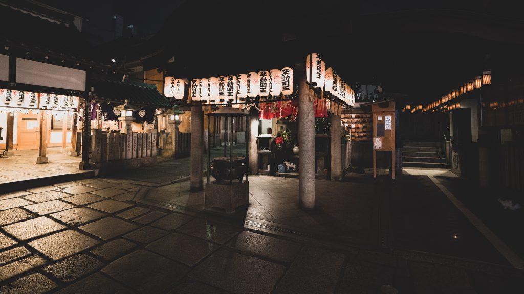 Small shrine at night with lanterns