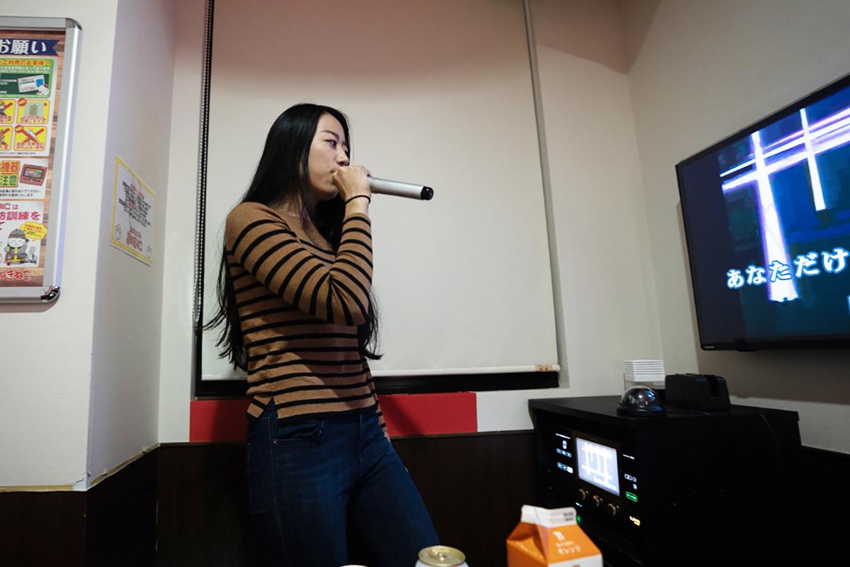 Singing at karaoke
